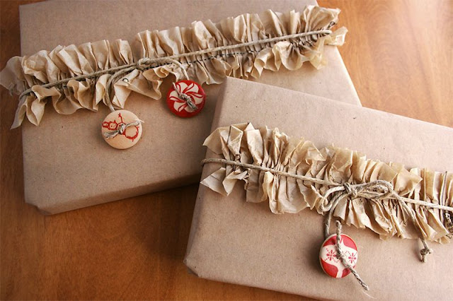 http://cosmocricket.typepad.com/cosmo_cricket/2012/12/8-techniques-for-gift-wrapping-with-kraft.html