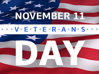Poster featuring the American flag with text: November 11 Veterans Day