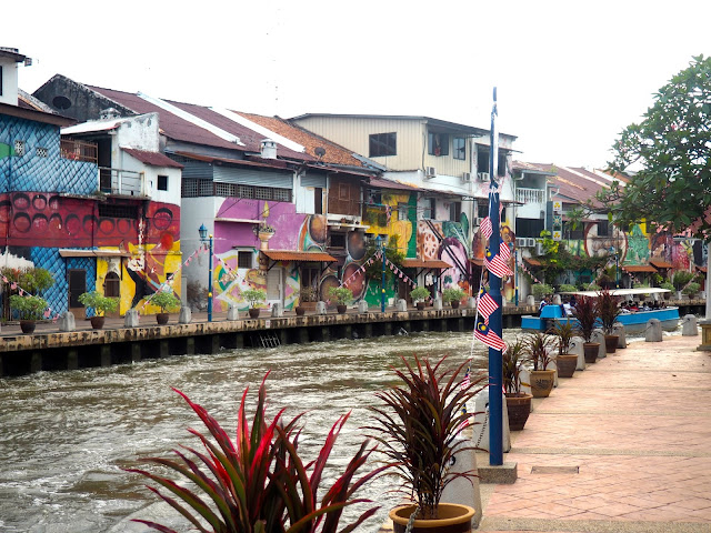 River and painted houses in Melaka, Malaysia