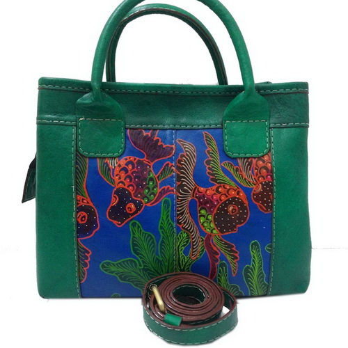 Tinuku Lin's Craft studio using batik and painting techniques applied to leather bag as decoupage artworks