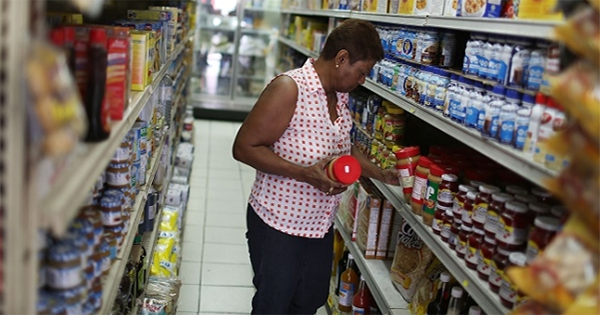 African American woman grocery shopping