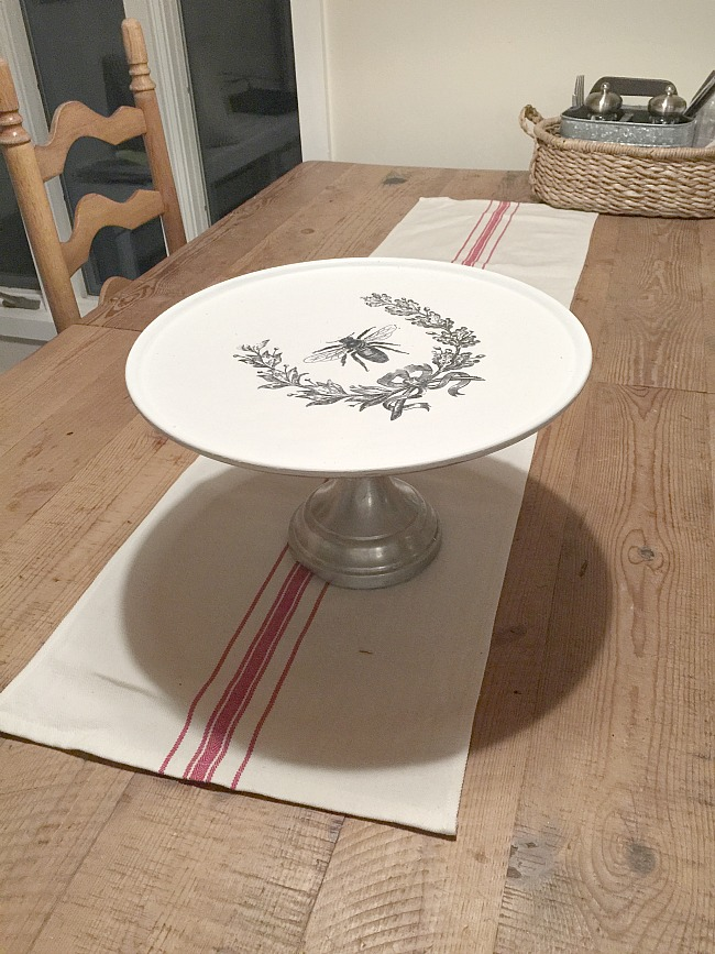 Bee image transferred to a pizza pedestal dish.