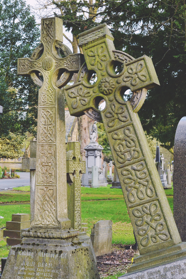 Fallen celtic cross headstone