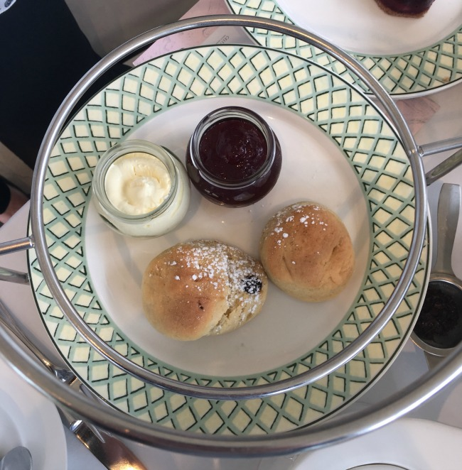 summer-afternoon-tea-at-the-celtic-manor-scones-on-a-plate-with-pot-of-jam-and-cream