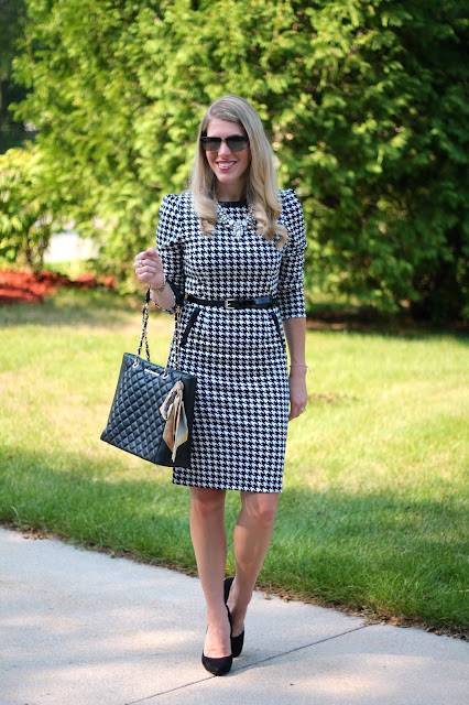 SheIn houndstooth dress, black heels, quilted leather tote, white statement necklace, Maui Jim sunglasses