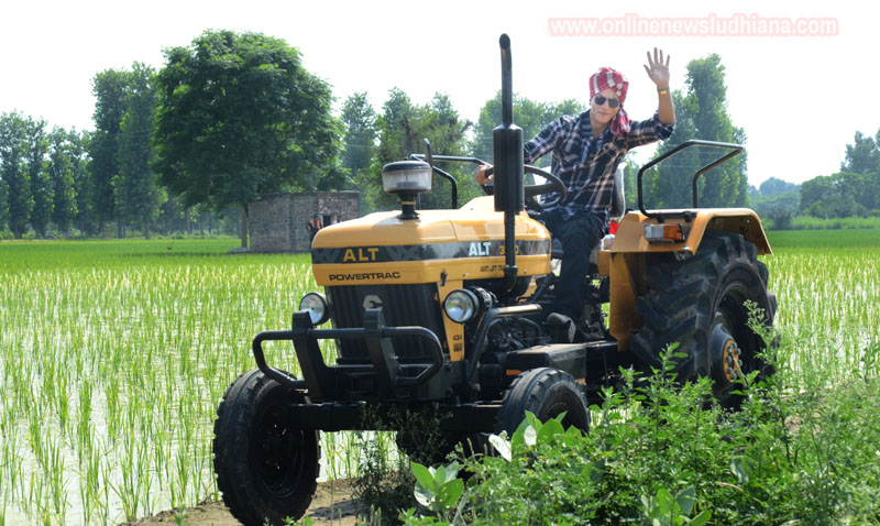 Shah Rukh Khan drives a tractor during shooting at Village Jhande in Ludhiana