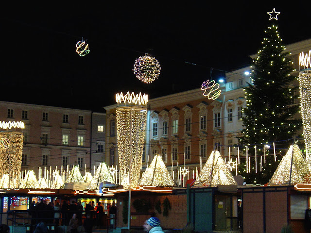 The Linz Christmas Market sparkles on a cold December eve in Austria.