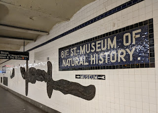 Embedded reproduction dinosaur fossils adorn the walls of the subway station for the Museum of Natural History, 81st Street, New York, New York