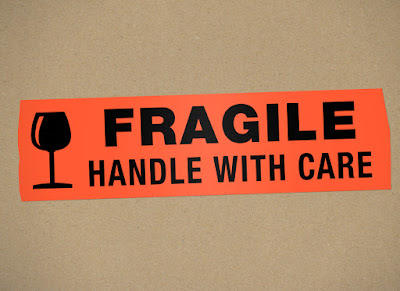 """A box labeled """"Fragile, Handle with Care"""""""