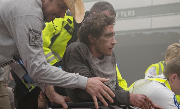 Jeff Bauman (Jake Gyllenhaal) being wheeled away after the Boston Marathon bombing in STRONGER (2017)