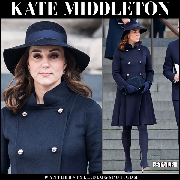 Kate Middleton in dark navy wool coat carolina herrera with navy suede pumps jimmy choo and wool hat winter maternity royal style december 14