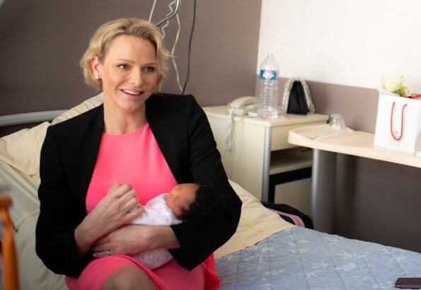 Princess Charlene wore a new asymmetric mulberry silk crepe de chine and georgette dress by Akris