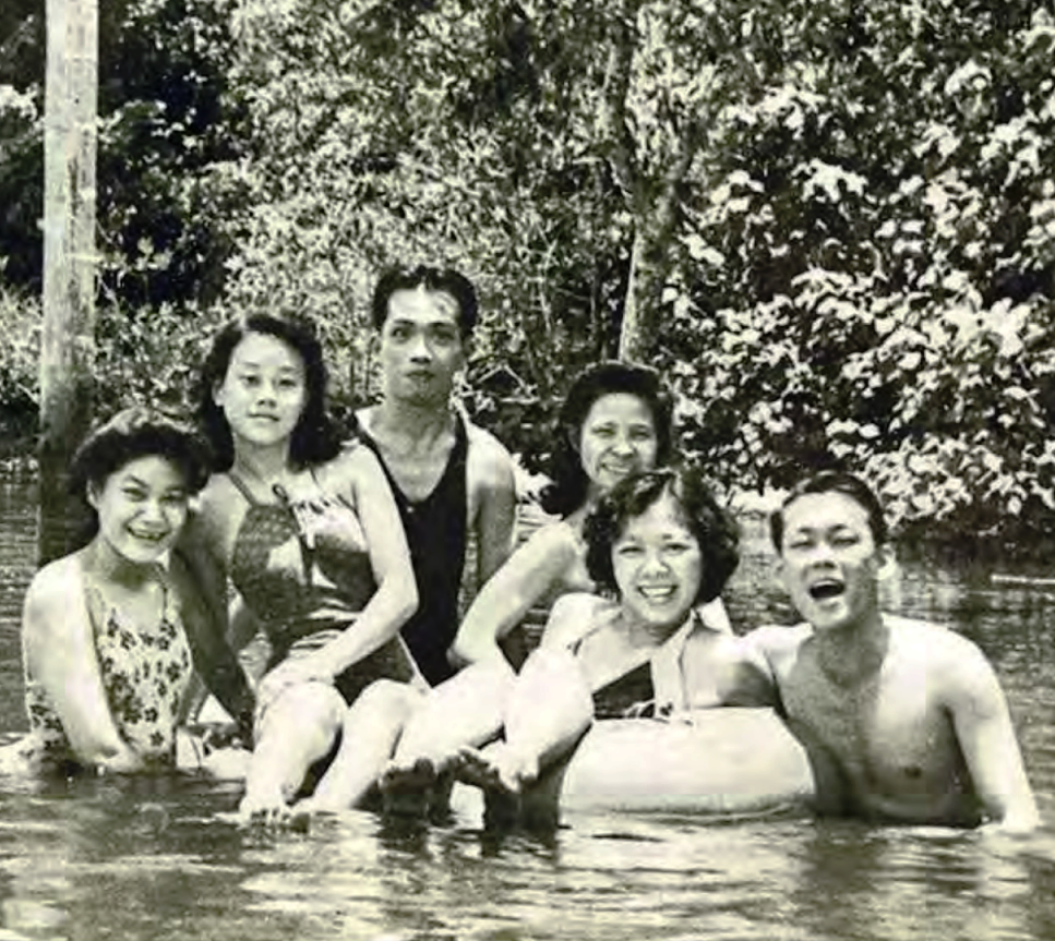 Mr. Lee (right) and Ms Kwa Geok Choo (second from right) in Punggol river with their friends, (from left) neighbour Chua Swee Sin; Mr. Lee's sister Monica; and Raffles College friend Kwan Sai Kheong and his wife Polly.