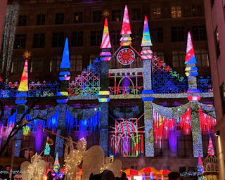 Multi-colored castle light display, Saks Fifth Avenue, near Rockefeller Center, New York, New York