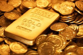 الذهب يهبط الى 1327 دولار فى  اول تراجع منذ ستة اسابيع