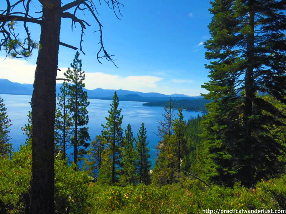 View from the Rubicon Trail through the pine trees in south Lake Tahoe, California. Lake Tahoe is a perfect weekend trip near the San Francisco Bay Area.