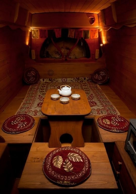 The low table is a perfect place to sip a cup of afternoon tea. - Amazing Off-Grid Traveling Home Was Made Out Of An Old Van… Wait Till You See The Inside.