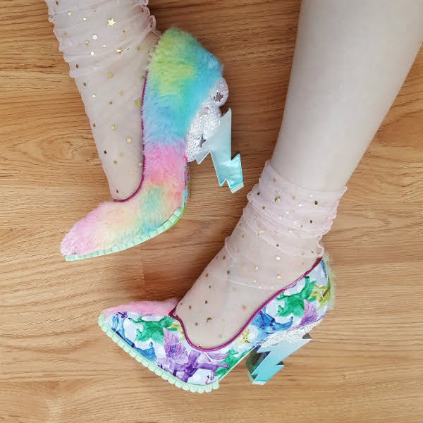 legs wearing tulle socks and showing one side of shoe in rainbow fluffy material, the other foot in polka dot unicorn print