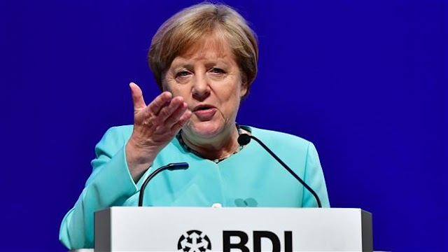German Chancellor Angela Merkel vows not to give up on EU-US free trade deal