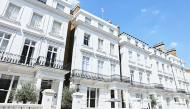 Exterior of white victorian townhouses of The Laslett Hotel in Notting Hill in the heart of West London