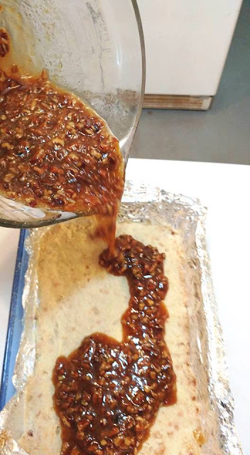 Pour Pecan Pie filling into shortbread cookie crust