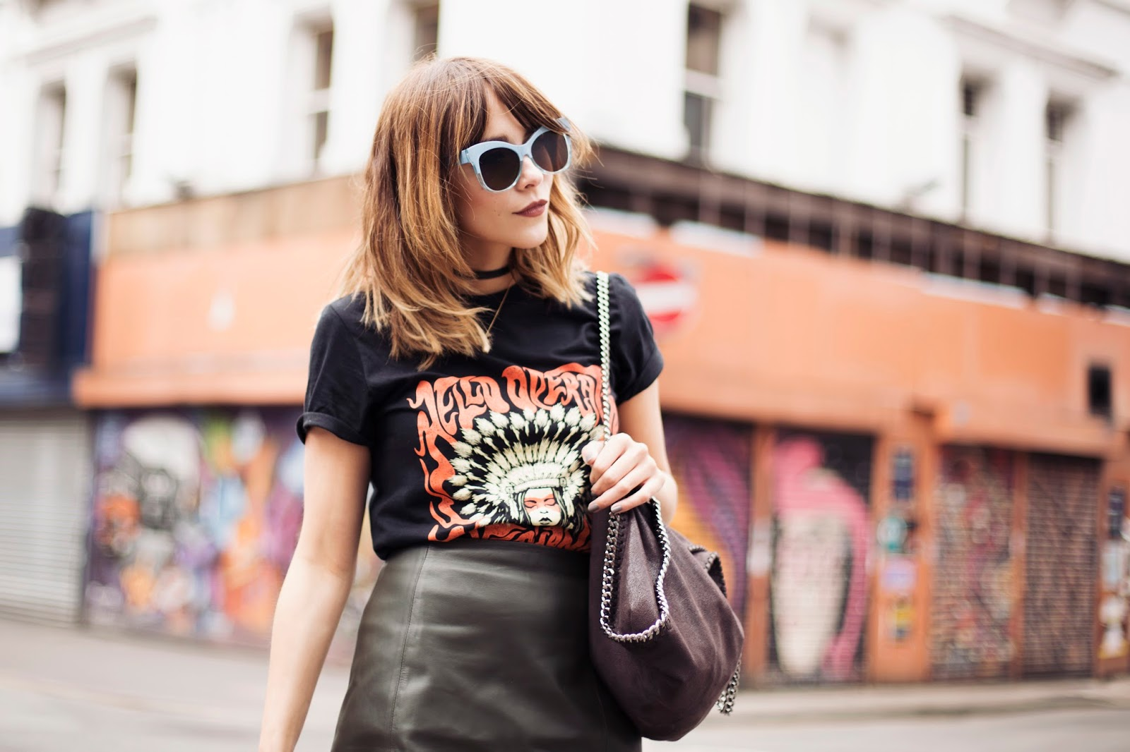 Megan Ellaby loves Hello Operator Band. Wearing band tee with leather skirt