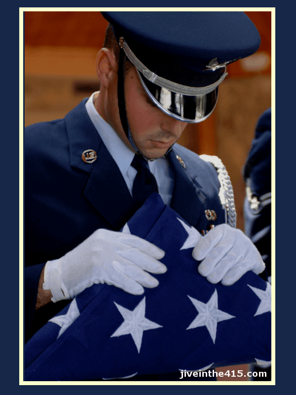 United States Air Force Airman with a US flag at a military funeral