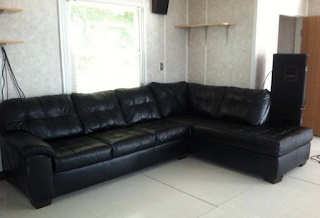 Picture depicts an early view of the discussion area that contains a couch without any decorations.