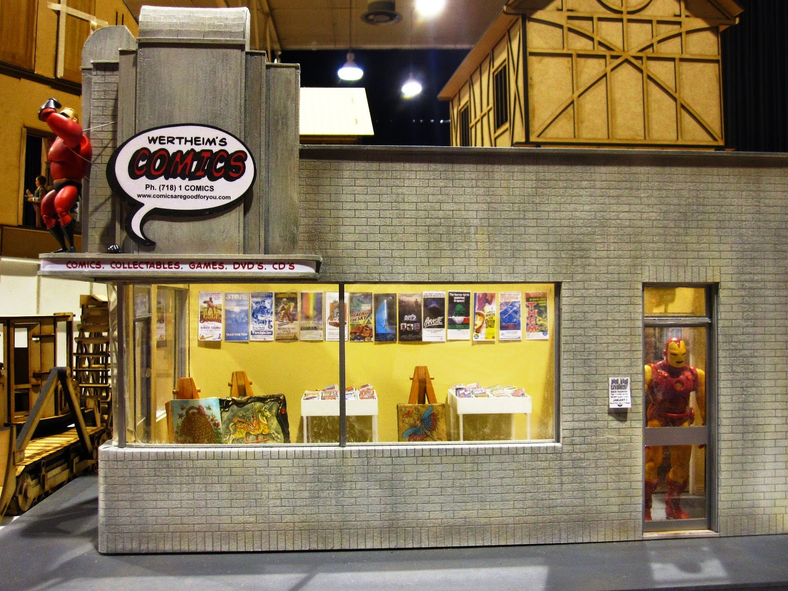 Modern miniature comic book store, side view.