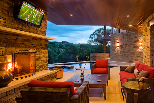 Photo of covered terrace with tv and fireplace