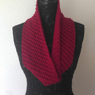 Deep red crocheted cowl on a black lace mannequin