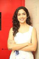 Actress Ritu Varma Stills in White Floral Short Dress at Kesava Movie Success Meet .COM 0093.JPG