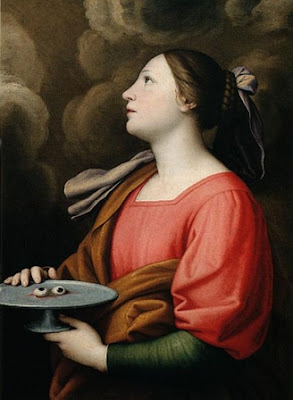 En la imagen Santa Lucia llevando sus ojos en una bandeja.