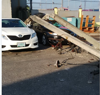 PHOTOS: Electric Pole Falls And Smashes Parked Car In Lekki, Lagos