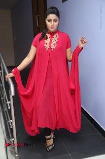 Actress Poorna Latest Stills in Red Dress at Rakshasi First Look Launch  0298.JPG
