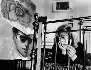 Pauline Boty on her bed with her painting With Love to Jean-Paul Belmondo