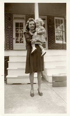 My mother holding me 24 years after women were guaranteed the right to vote.