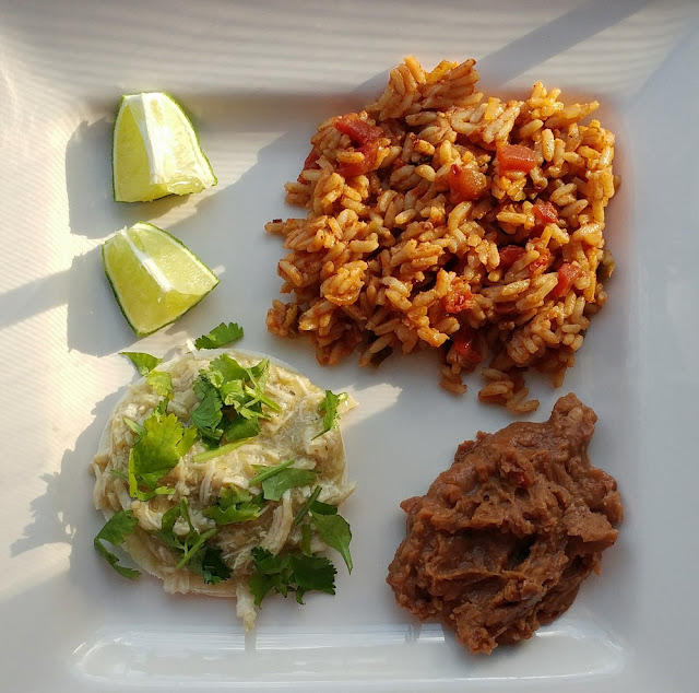 Shredded Chicken Verde tacos with refried beans and Spanish style rice
