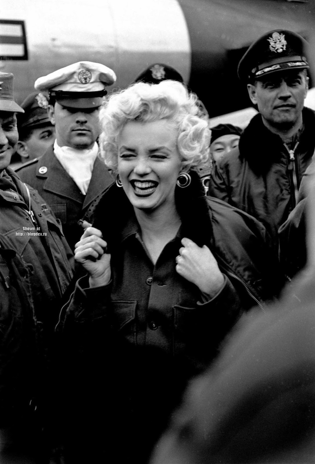 Marilyn Monroe received an escort while in Korea for her USO tour.