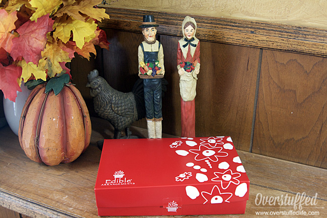 Red edible arrangements box containing chocolate covered fruit