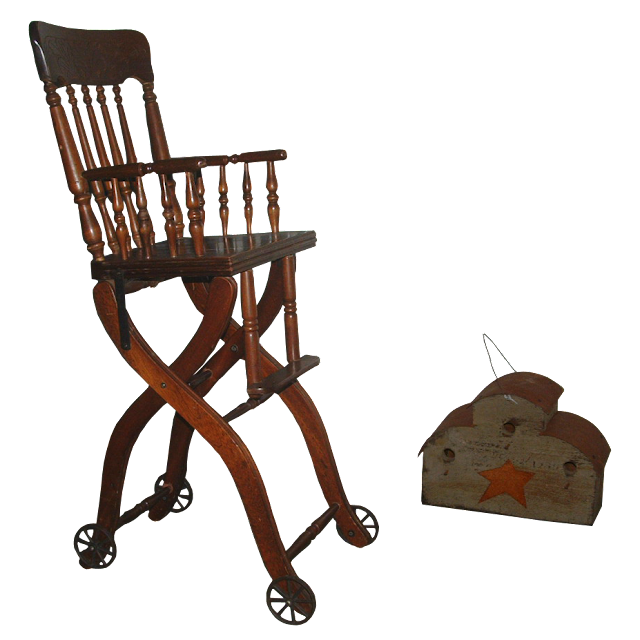 Late Victorian period wooden high chair that's missing it's tray, but does have the old iron wheels on both front and back legs.
