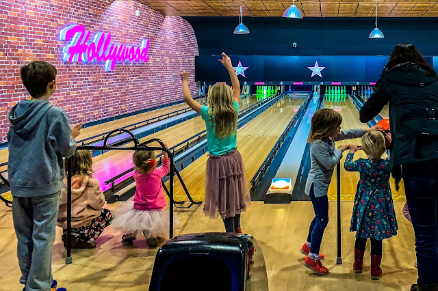Children bowling with bumpers and rails at Hollywood Bowl
