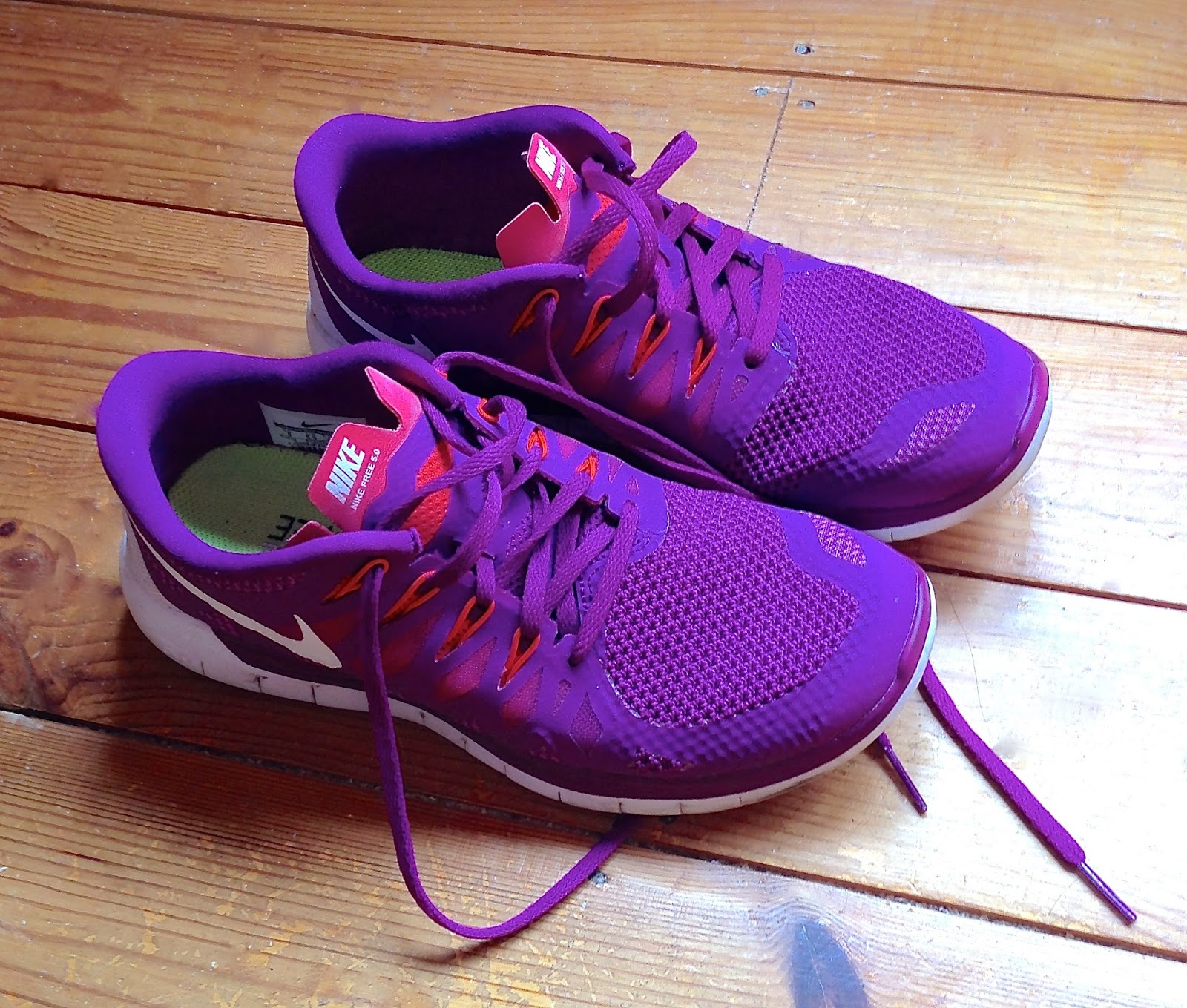 Purple and orange nike free