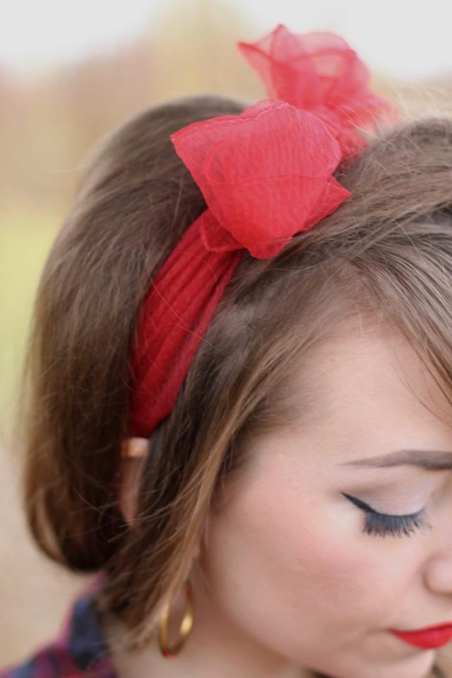 Red hairscarf and gold hoop earrings
