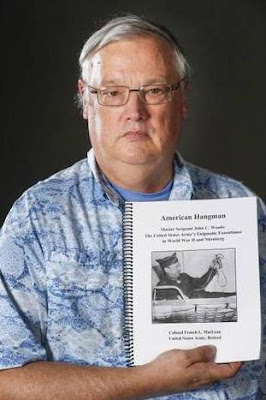 "Col. (Ret.) French MacLean with a draft of his upcoming book, ""American Hangman"""