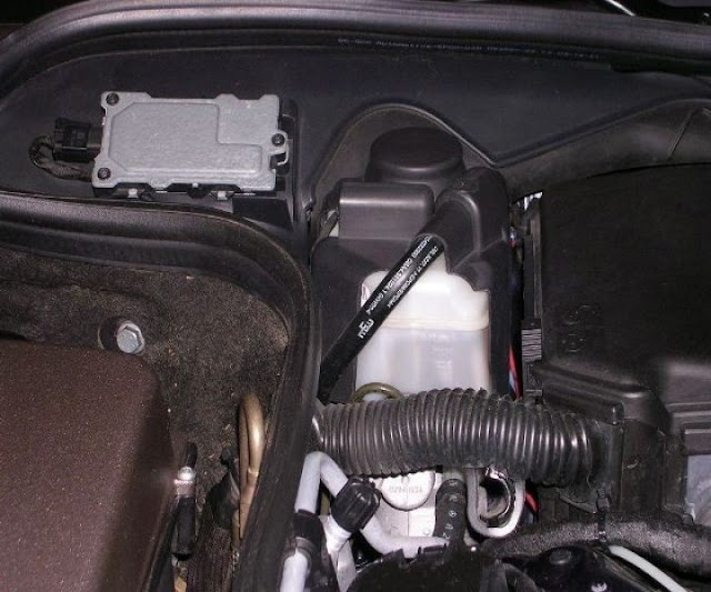 Re-install the plastic reservoir cover