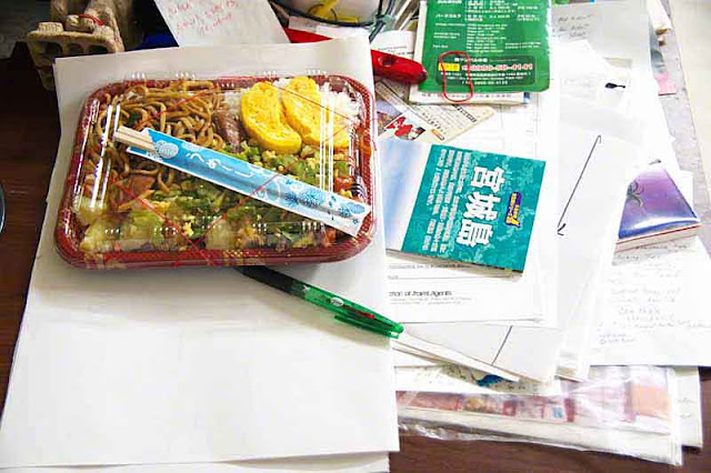 Messy desk, bento large enough for the entire day