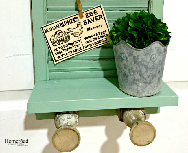 green shutter with shelf and clips with tags