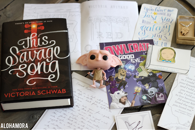 Owlcrate's July YA Literature Subscription box. The theme was Good vs. Evil.  Dobby PopFunko Star Wars Millenium Falcon necklace, magnetic bookmark, and humrorous fantasty with a romance This Salvage Song by Victoria Schwab for the book.  fandom, fun, funny, subsctription box, harry potter, Alohamora Open a Book http://alohamoraopenabook.blogspot.com/