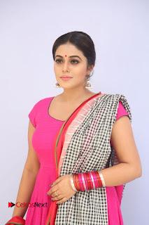 Actress Poorna Pictures in Red Salwar Kameez at Jayammu Nischayammu Raa Teaser Launch 0003